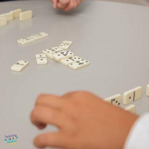 Kids playing dominoes