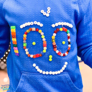 blue shirt with 100 legos glued to it